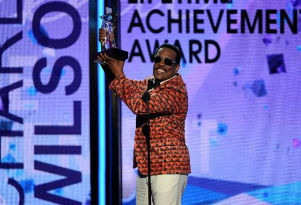 harlie Wilson accepts the lifetime achievement award at the BET Awards at the Nokia Theatre on Sunday, June 30, 2013, in Los Angeles. (AP)