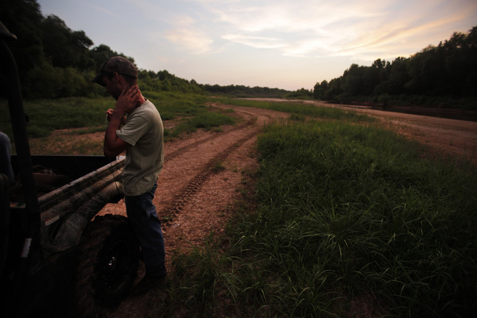 Johnny Heskett prepares a hog trap during a hunting trip near Indianola, Okla., Friday, July 6, 2012.  Photo by Garett Fisbeck, The Oklahoman