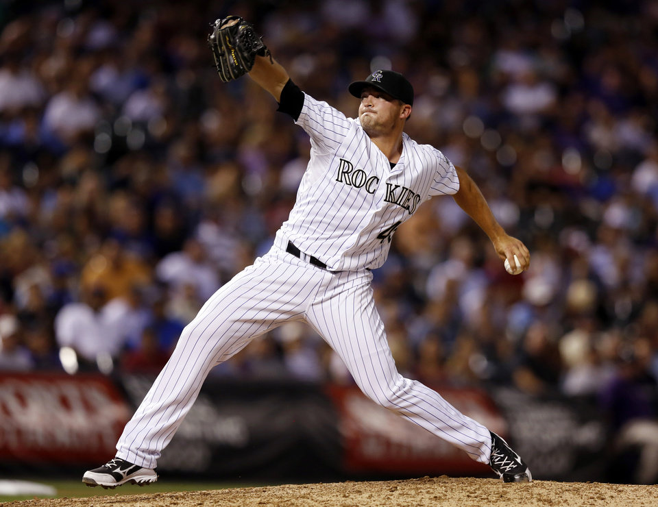 Photo - Colorado Rockies relief pitcher Rex Brothers throws against the Kansas City Royals during the eighth inning of a baseball game Tuesday, Aug. 19, 2014, in Denver. (AP Photo/Jack Dempsey)