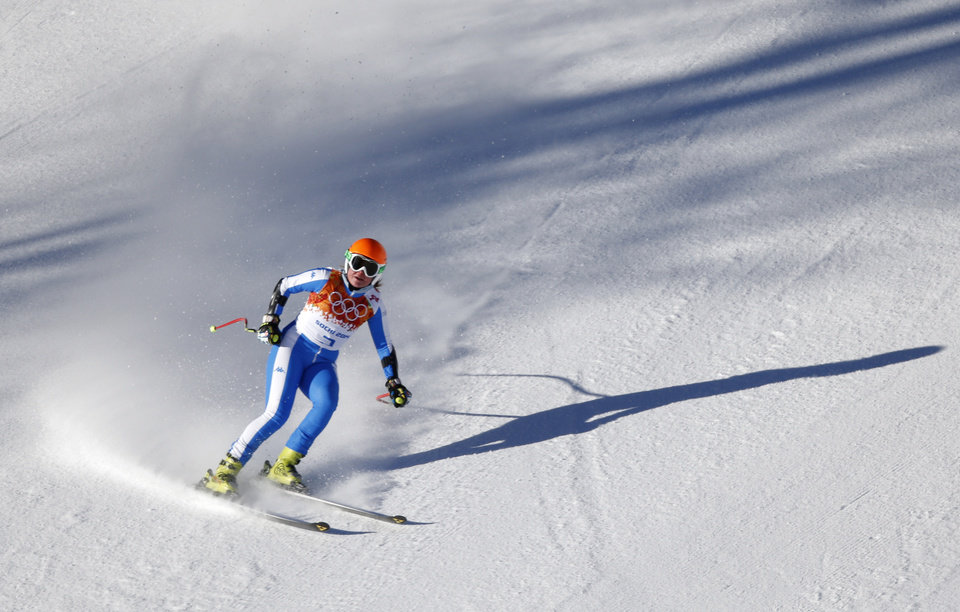 Photo - Italy's Verena Stuffer comes to a halt in the finish area after completing a women's downhill training run at the Sochi 2014 Winter Olympics, Thursday, Feb. 6, 2014, in Krasnaya Polyana, Russia.  (AP Photo/Christophe Ena)