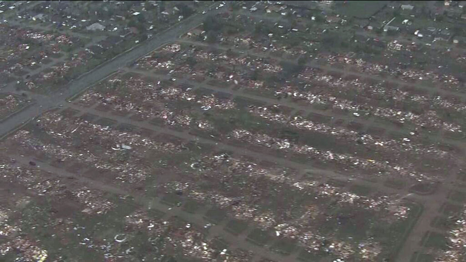 Photo - CORRECTS TORNADO MEASUREMENT TO NUMBER REPORTED BY THE NATIONAL WEATHER SERVICE - This photo provided by KFOR-TV shows homes flattened outside Moore, Okla., Monday, May 20, 2013. A monstrous tornado as much as half a mile wide roared through the Oklahoma City suburbs Monday, flattening entire neighborhoods, setting buildings on fire and landing a direct blow on an elementary school. (AP Photo/KFOR-TV) MANDATORY CREDIT