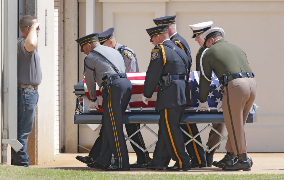 Photo - Honor guard members carry the the body of fallen Logan County Deputy David Wade before the start of his funeral service in Guthrie, Monday April 24, 2017. Photo By Steve Gooch, The Oklahoman
