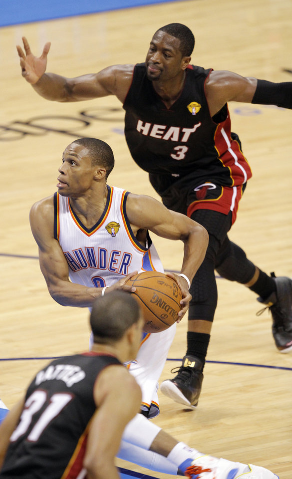 Photo - Oklahoma City's Russell Westbrook (0) drives past Miami's Dwyane Wade (3) during Game 2 of the NBA Finals between the Oklahoma City Thunder and the Miami Heat at Chesapeake Energy Arena in Oklahoma City, Thursday, June 14, 2012. Photo by Chris Landsberger, The Oklahoman