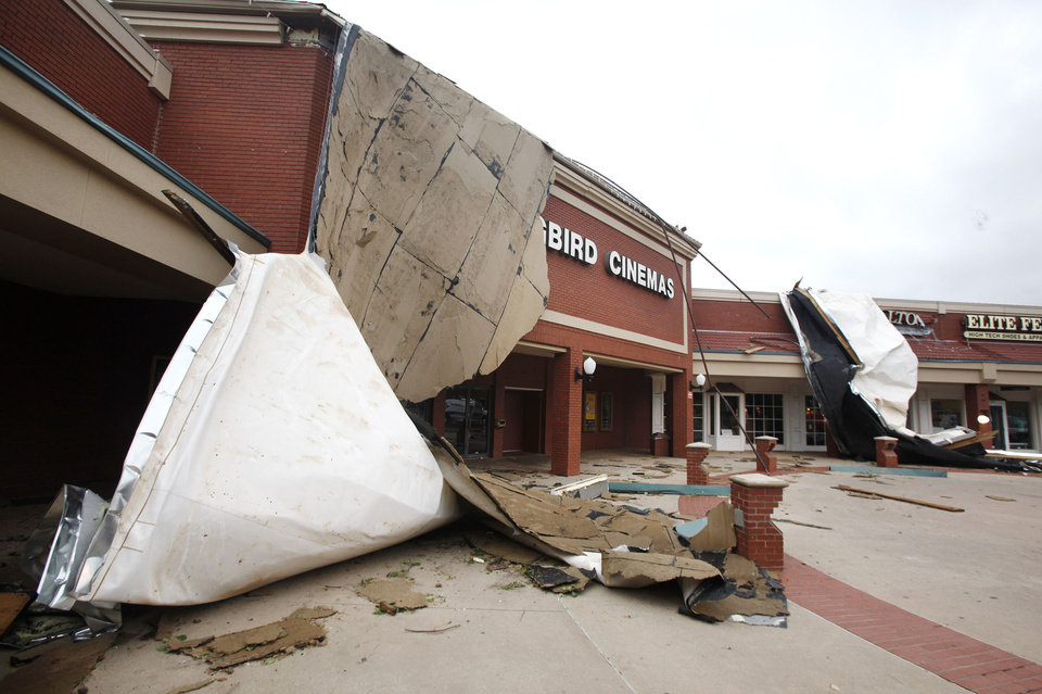 Photo - Roof damage to Kickingbird Cinema, on Danforth in Edmond, after a thunderstorm moved through Wednesday, Aug. 10, 2011.  Photo by Paul B. Southerland, The Oklahoman