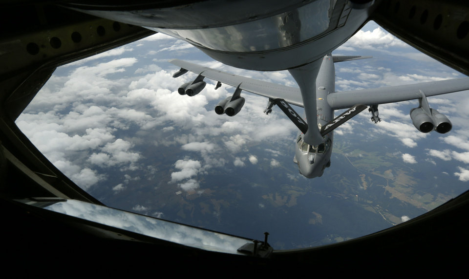 Photo -   Above:  A B-52 Stratofortress rises to meet a KC-135 Stratotanker's  refueling boom during a practice flight. The tanker is from the 507th Air Refueling Wing. [Photos by Paul Hellstern, The Oklahoman]