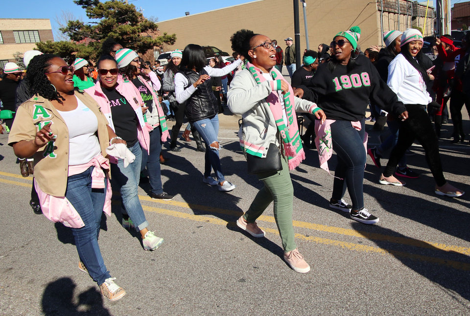Photo - Members of Alpha Kappa Alpha walk at the MLK Day Parade along Walker Ave. during celebrations of Dr. Martin Luther King, Jr. holiday, Monday, January 20, 2019. [Photo by Doug Hoke/The Oklahoman]