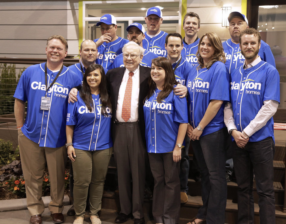 Photo - Billionaire investor Warren Buffett poses for a photo with employees of Clayton Homes, a Berkshire Hathaway subsidiary, while touring the exhibition floor in Omaha, Neb., Friday, May 2, 2014,  one day before the Berkshire Hathaway annual shareholders meeting Saturday. (AP Photo/Nati Harnik)