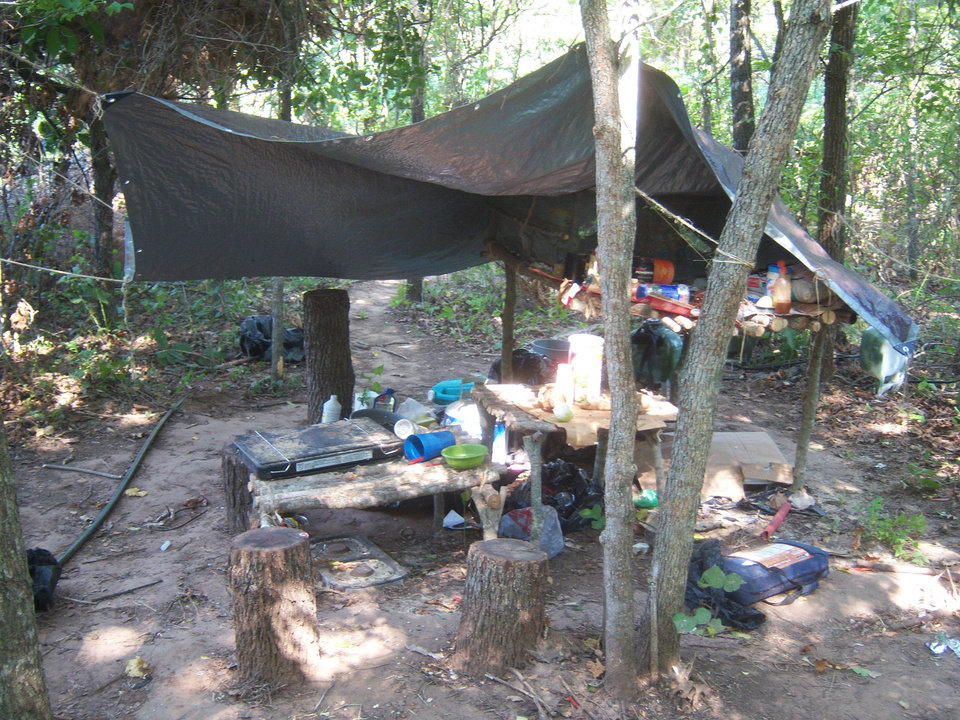 Photo - A campsite inside one of the marijuana patches  uncovered by authorities is pictured Monday.