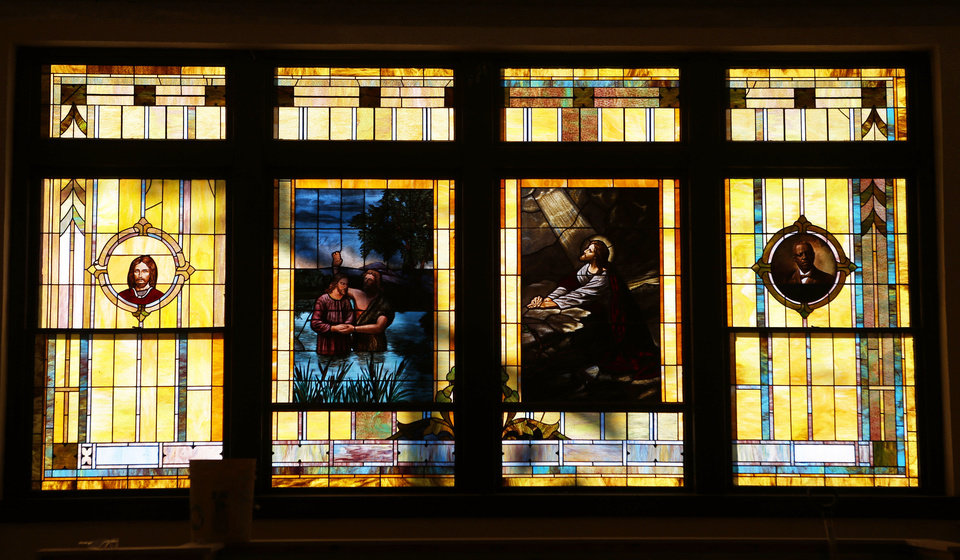 Photo - A stained-glass window panel is seen as construction continues in Calvary Baptist Church, 300 N Walnut, in the Deep Deuce district.