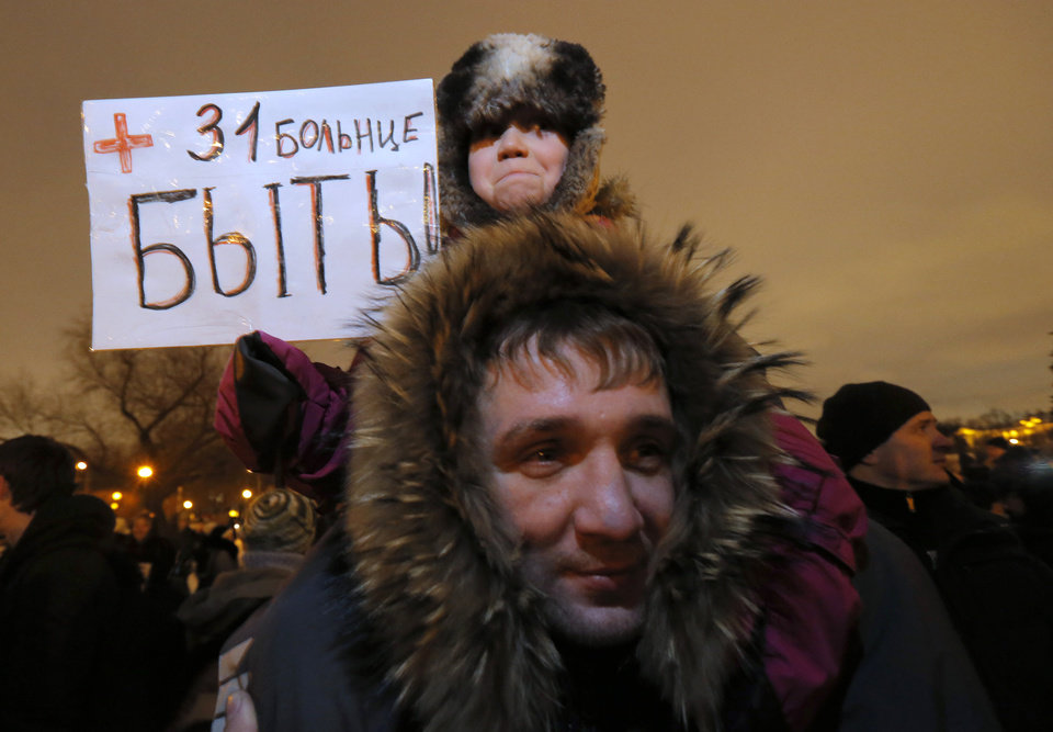 "Demonstrators with a poster reading ""Let hospital No. 31 be""  take part in a protest against plans to shut down City Hospital No. 31 in St. Petersburg, Russia, Wednesday, Jan. 23, 2013. Some 1,500 thousand people gathered for a rally against plans to shut a clinic specialized in treating children with cancer in order to turn it into a medical center for the nation's top judges. The authorities intention to turn City Hospital No. 31 into a clinic that would exclusively serve judges of Russia's top courts, which are being relocated to St.Petersburg from Moscow, has caused a strong public dismay. On Wednesday, St.Petersburg Governor's office said that the hospital will continue to serve patients as before and there is no plan to change its location or profile.  (AP Photo/Dmitry Lovetsky)"