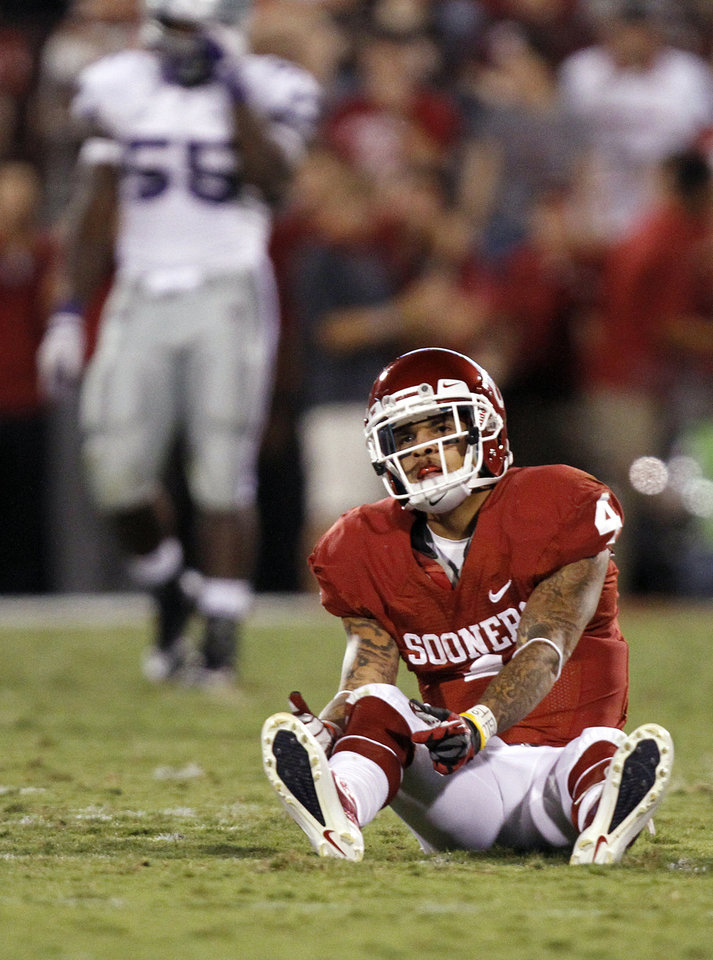 Oklahoma\'s Kenny Stills (4) reacts after missing a catch during the college football game between the University of Oklahoma Sooners (OU) and the Kansas State University Wildcats (KSU) at the Gaylord Family-Memorial Stadium on Saturday, Sept. 22, 2012, in Norman, Okla. Photo by Chris Landsberger, The Oklahoman