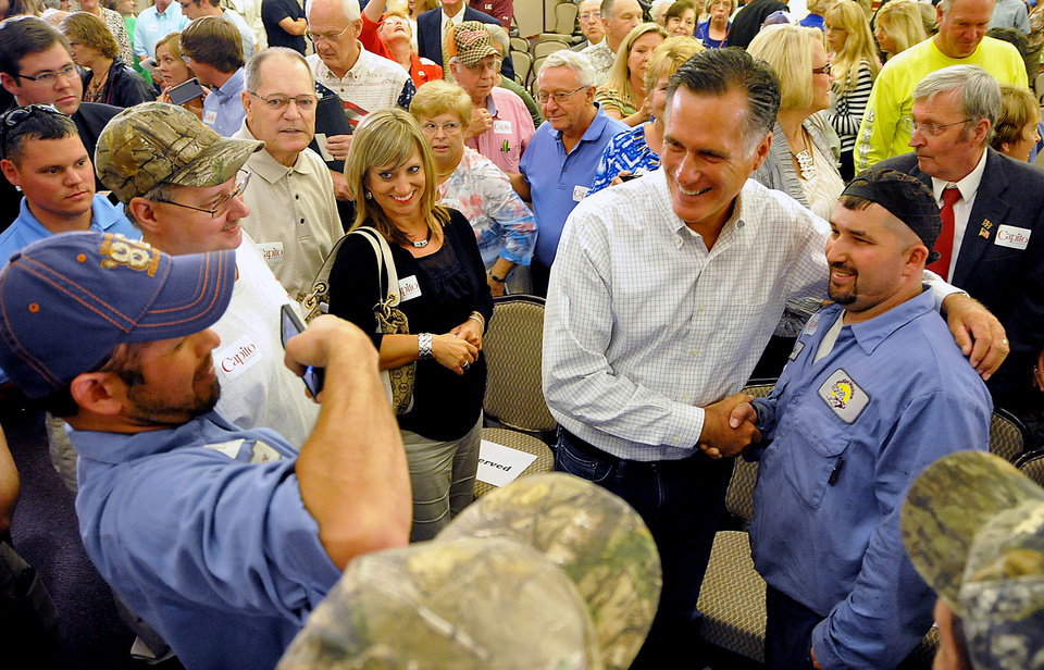 Photo - Former Massachusetts Gov. Mitt Romney takes a photo with supporter Sam Massey at Tamarack during the Working for Jobs Rally in Beckley, W.Va., Tuesday, Aug. 19, 2014. (AP Photo/Chris Tilley)