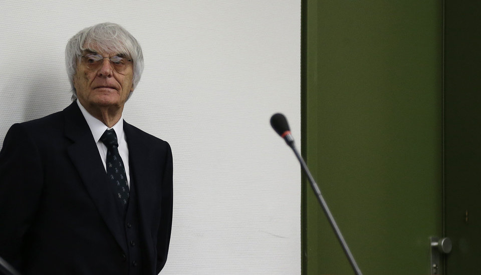 Photo - Formula One boss Bernie Ecclestone arrives for his trial in the regional court in Munich, southern Germany, Tuesday, July 29, 2014. Ecclestone is charged with bribery and incitement to breach of trust