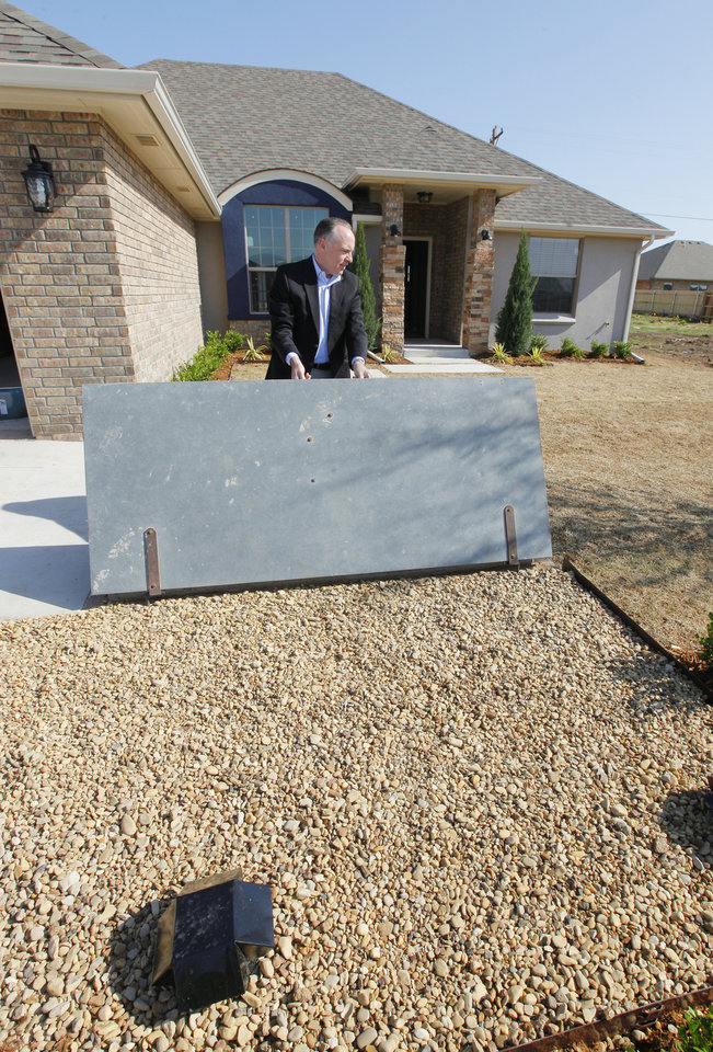 Photo -  Homebuilder Jay Evans of Two Structures Homes shows the storm shelter in front of the House of Hope his company is building at 841 SW 11 in Moore. Photo by Paul B. Southerland, The Oklahoman   PAUL B. SOUTHERLAND -  PAUL B. SOUTHERLAND