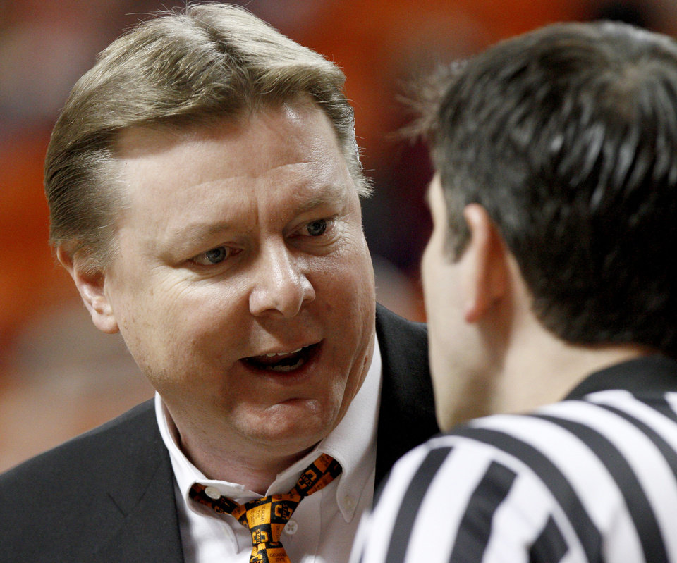 Photo - OSU coach Kurt Budke argues with an official during a timeout in the Big 12 women's college basketball game between Oklahoma State University and Texas A&M at Gallagher-Iba Arena in Stillwater, Okla., on Wednesday, Jan. 12, 2011.  Photo by Bryan Terry, The Oklahoman