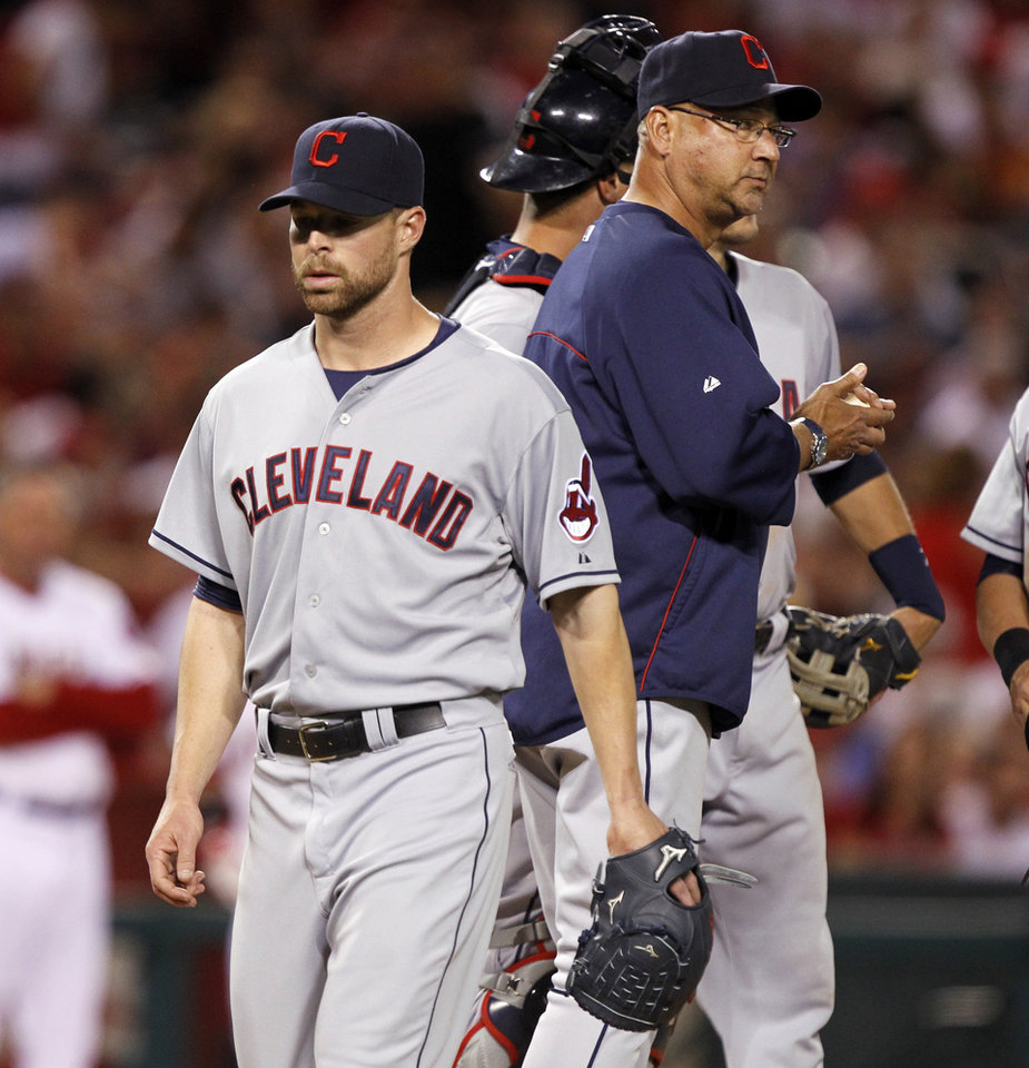 Photo - Cleveland Indians manager Terry Francona, right, pulls starting pitcher Corey Kluber, left, out in the fifth inning of a baseball game against the Los Angeles Angels on Tuesday, April 29, 2014, in Anaheim, Calif. (AP Photo/Alex Gallardo)
