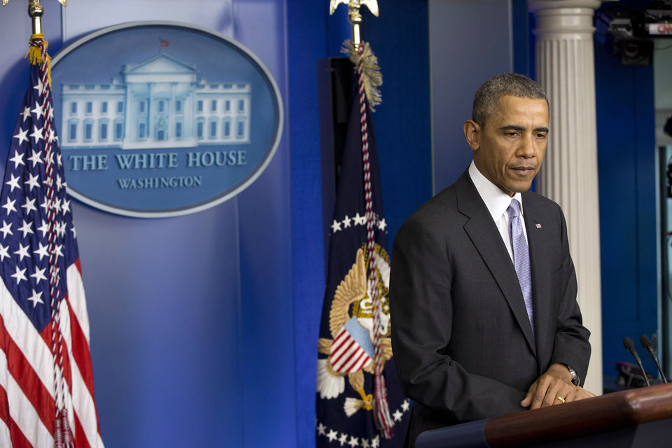 Photo - President Barack Obama speaks about the ongoing situation in Ukraine in the Brady Press Briefing Room of the White House in Washington, Friday, Feb. 28, 2014. Obama warned Russia