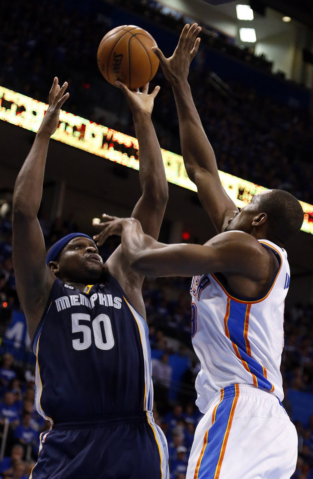 Oklahoma City\'s Serge Ibaka (9) blocks the shot of Memphis\' Zach Randolph (50) during Game 1 in the second round of the NBA playoffs between the Oklahoma City Thunder and the Memphis Grizzlies at Chesapeake Energy Arena in Oklahoma City, Sunday, May 5, 2013. Photo by Sarah Phipps, The Oklahoman