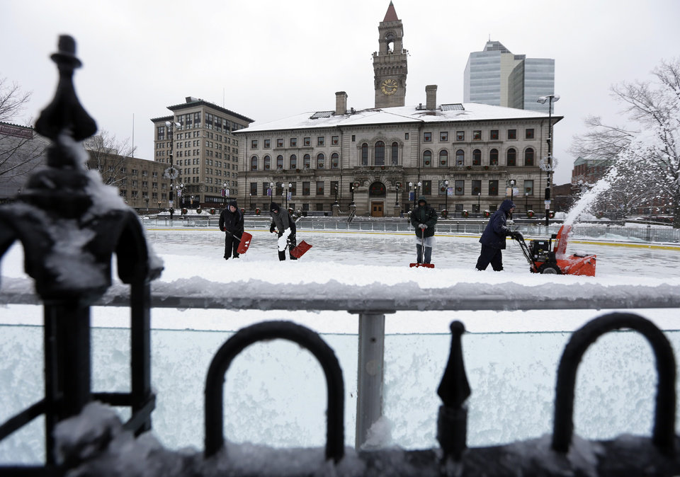 Photo - Workers remove snow from an ice skating rink near Worcester City Hall, in Worcester, Mass., Thursday, Dec. 27, 2012.  Areas in the north and west of the state have received a blanket of heavy, wet snow. (AP Photo/Steven Senne)