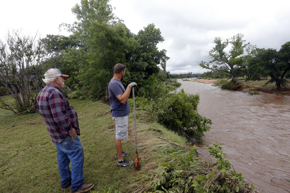 Photo - Royce Samples and his grandson Justin Daugherty look at  the West Cache Creek next to their property, Sunday, May 24, 2015, in Cache, Okla., Photo by Sarah Phipps, The Oklahoman