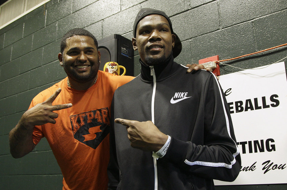 San Francisco Giants third baseman Pablo Sandoval, left, poses for photographs with Oklahoma City Thunder NBA basketball player Kevin Durant before a baseball game between the Giants and the Colorado Rockies, Wednesday, April 10, 2013, in San Francisco. (AP Photo/Jeff Chiu) Jeff Chiu
