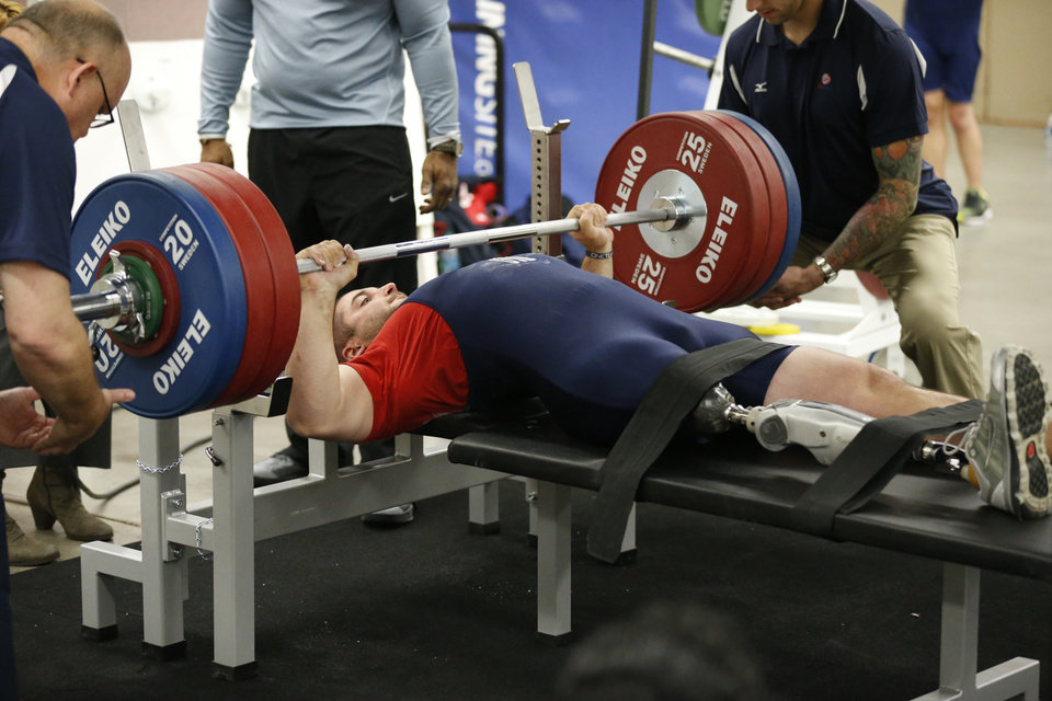 Photo - Jacob Schrom lifts during the IPC Powerlifting competition during the Sports and Health Festival on Saturday, Feb. 16, 2013  in Oklahoma City, Okla. Photo by Steve Sisney, The Oklahoman