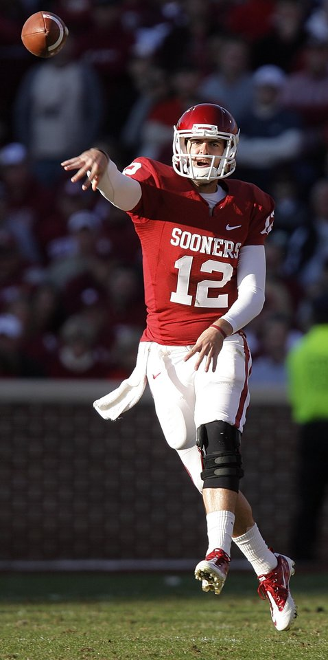Photo - Oklahoma's Landry Jones (12) throws the ball during the first half of the college football game between the University of Oklahoma Sooners (OU) and the Texas Tech Red Raiders (TTU) at the Gaylord Family Memorial Stadium on Saturday, Nov. 13, 2010, in Norman, Okla.  Photo by Chris Landsberger, The Oklahoman