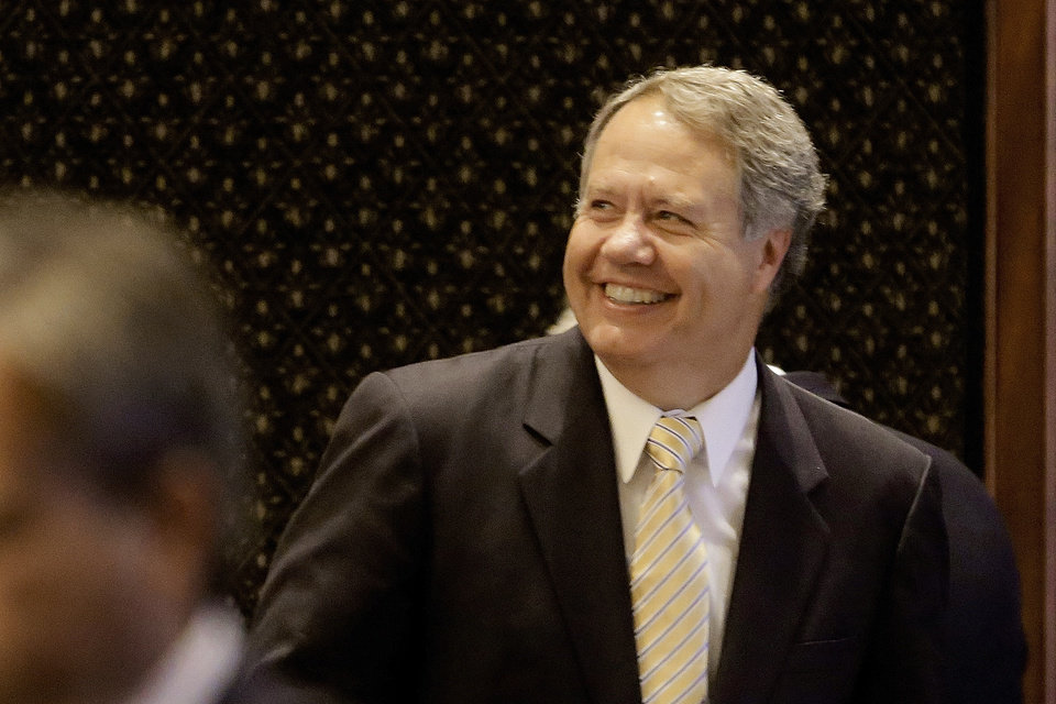 Photo - Illinois Rep. Jay Hoffman, D-Belleville, smiles while on the House floor during session at the Illinois State Capitol Tuesday, July 9, 2013, in Springfield, Ill. The Illinois House has rejected Illinois Gov. Pat Quinn's changes to legislation allowing the carrying of concealed guns on the deadline for action set by a federal court.(AP Photo/Seth Perlman)