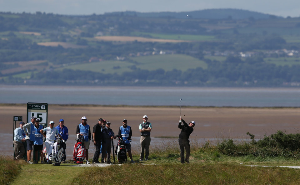 Photo - Phil Mickleson of the US plays off the 15th tee during a practice round ahead of the British Open Golf championship at the Royal Liverpool golf club, Hoylake, England, Tuesday July 15, 2014. The British Open starts on Thursday July 17. (AP Photo/Jon Super)