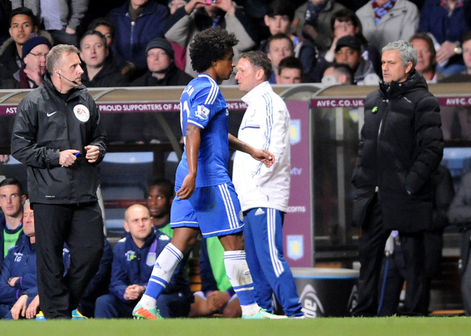 Photo - Chelsea's Willian, center, leaves the pitch after being sent off during the English Premier League soccer match between Aston Villa and Chelsea at Villa Park, Birmingham, England, Saturday, March 15, 2014.  (AP Photo/Rui Vieira)