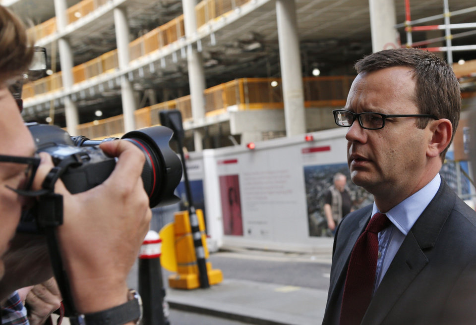 Photo - Andy Coulson, right, former News of the World editor, arrives at the Central Criminal Court in London, Wednesday, June 25, 2014. Coulson was convicted of phone hacking Tuesday, but fellow editor Rebekah Brooks was acquitted after a monthslong trial centering on illegal activity at the heart of Rupert Murdoch's newspaper empire. A jury at London's Old Bailey unanimously found Coulson, the former spin doctor of British Prime Minister David Cameron, guilty of conspiring to intercept communications. The nearly eight-month trial was triggered by revelations that for years the News of the World used illegal eavesdropping to get stories, listening in on the voicemails of celebrities, politicians and even crime victims. (AP Photo/Lefteris Pitarakis)
