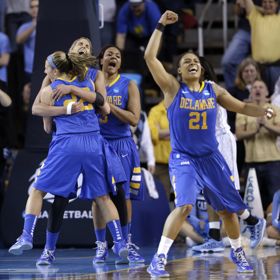 Delaware guards Lauren Carra, from left, Elena Delle Donne, Jaquetta May and Trumae Lucas celebrate after winning a second-round game against North Carolina in the women\'s NCAA college basketball tournament in Newark, Del., Tuesday, March 26, 2013. Delaware won 78-69. (AP Photo/Patrick Semansky)