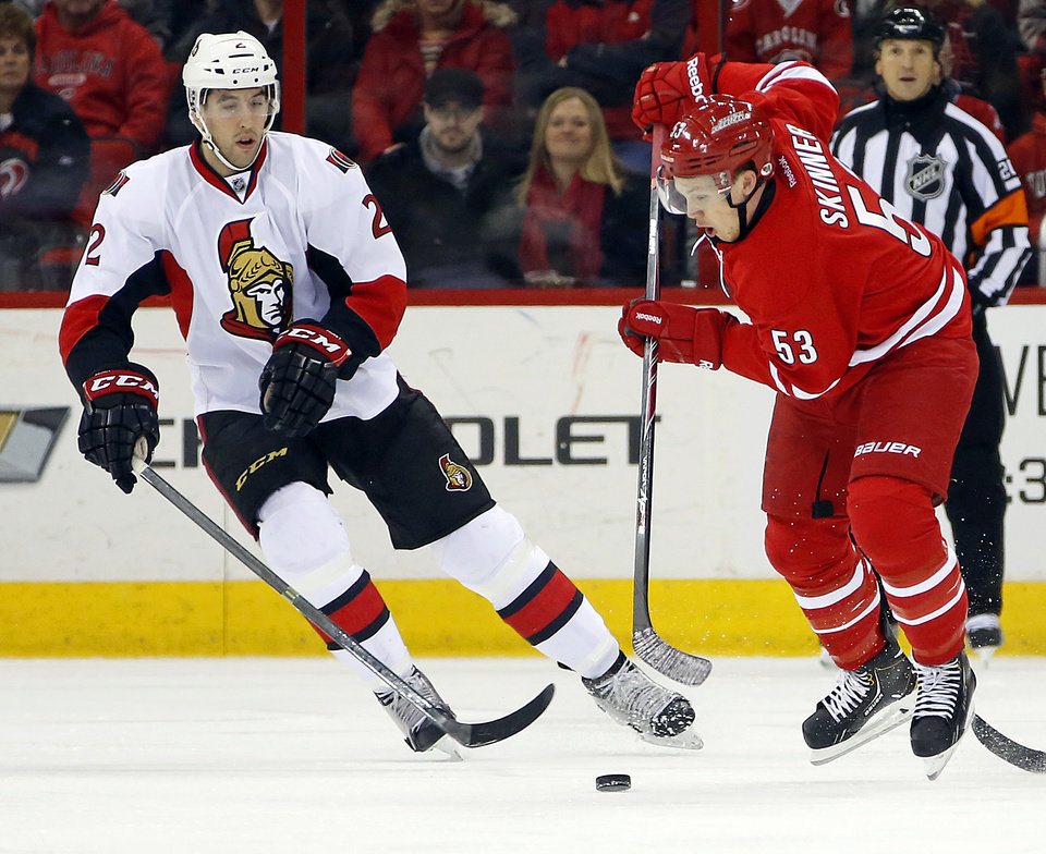 Photo - Carolina Hurricanes' Jeff Skinner (53) works the puck in front of Ottawa Senators' Jared Cowen (2) during the first period of an NHL hockey game in Raleigh, N.C., Saturday, Jan. 25, 2014. (AP Photo/Karl B DeBlaker)