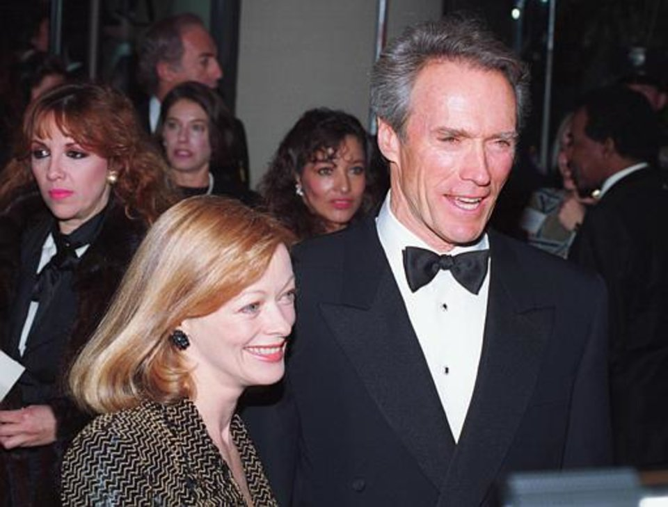"Oscar nominee Clint Eastwood arrives with Frances Fisher, his co-star in ""Unforgiven,"" at the 1992 50th Annual Golden Globe Awards presentation in Beverly Hills, Ca., Jan. 24, 1993.  Eastwood won the best director award for ""Unforgiven.""  (AP Photo/Reed Saxon)"