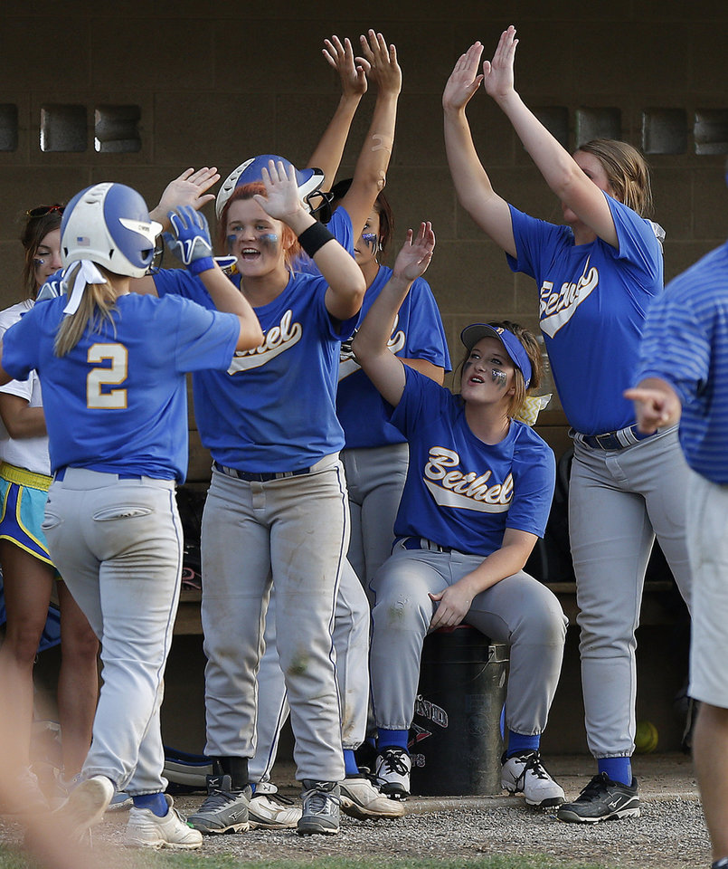 Photo -                    Bethel players celebrate a run in the third inning of their Class 5A state slowpitch softball championship game against Sequoyah Tahlequah in Shawnee on Tuesday.                     Photo by Bryan Terry, The Oklahoman