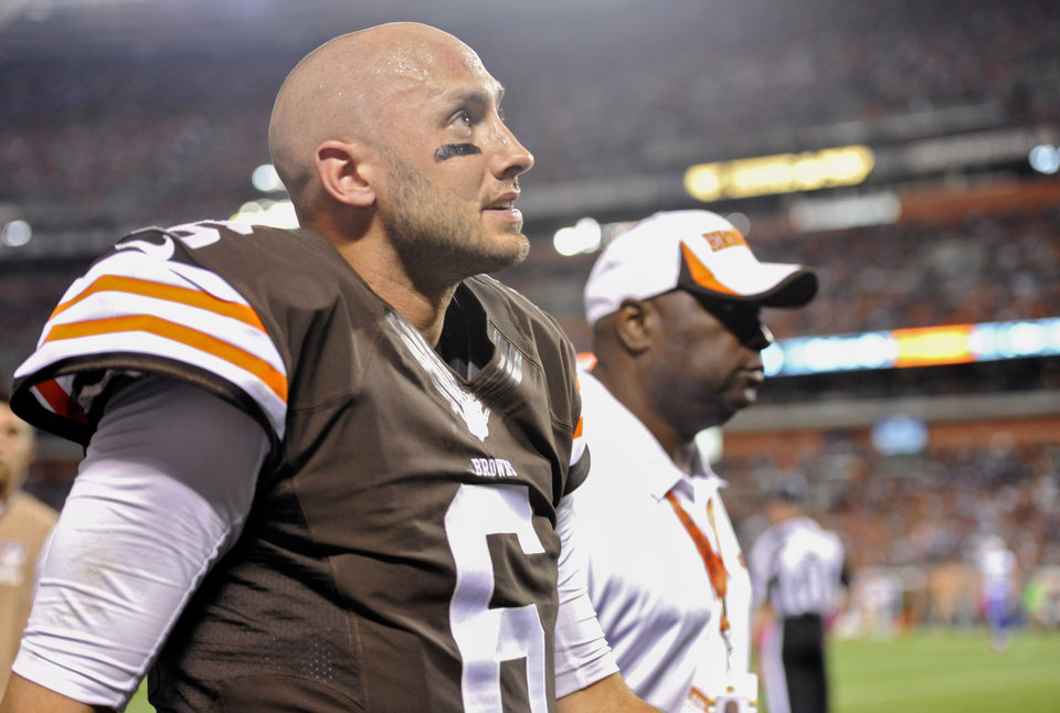Photo - In this photo taken on Thursday, Oct. 3, 2013, Cleveland Browns quarterback Brian Hoyer limps off the field with a member of the training staff early in an NFL football game against the Buffalo Bills in Cleveland. Hoyer, the hometown quarterback who sparked the Browns to two straight wins, will miss the rest of the season with a torn right knee ligament. (AP Photo/David Richard)