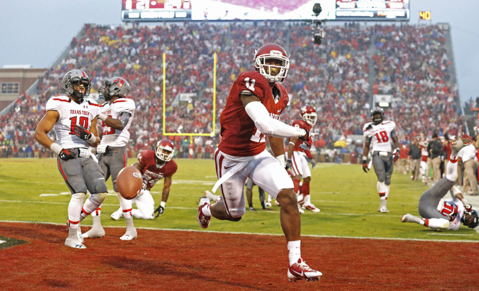 Photo -  Oklahoma's Lacoltan Bester (11) celebrates after a touchdown during a college football game between the University of Oklahoma Sooners (OU) and the Texas Tech Red Raiders at Gaylord Family-Oklahoma Memorial Stadium in Norman, Okla., on Saturday, Oct. 26, 2013. Oklahoma won 38-30. Photo by Bryan Terry, The Oklahoman