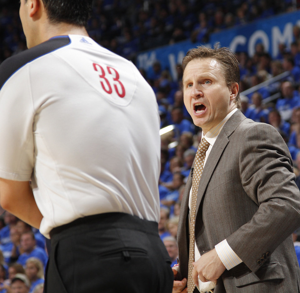 Photo - Coach Scott Brooks argues with the official during game one of the Western Conference semifinals between the Memphis Grizzlies and the Oklahoma City Thunder in the NBA basketball playoffs at Oklahoma City Arena in Oklahoma City, Sunday, May 1, 2011. Photo by Chris Landsberger, The Oklahoman