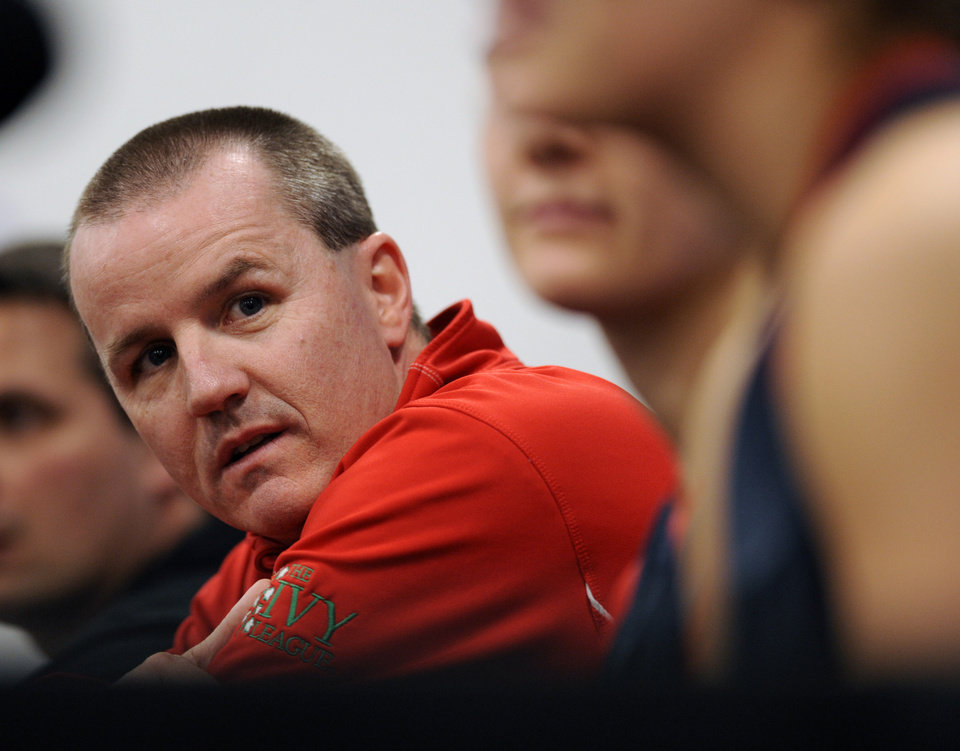 Photo - Penn head coach Mike McLaughlin listens during a news conference before the first round of the NCAA women's college basketball tournament, Saturday, March 22, 2014, in College Park, Md. (AP Photo/Gail Burton)