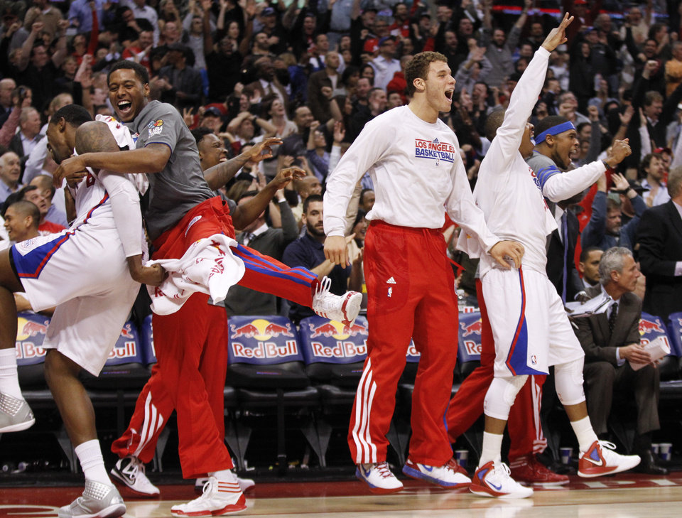 Photo -   Los Angeles Clippers bench celebrates a basket against the Oklahoma City Thunder during the first half of an NBA basketball game in Los Angeles, Monday, Jan. 30, 2012. (AP Photo/Chris Carlson)