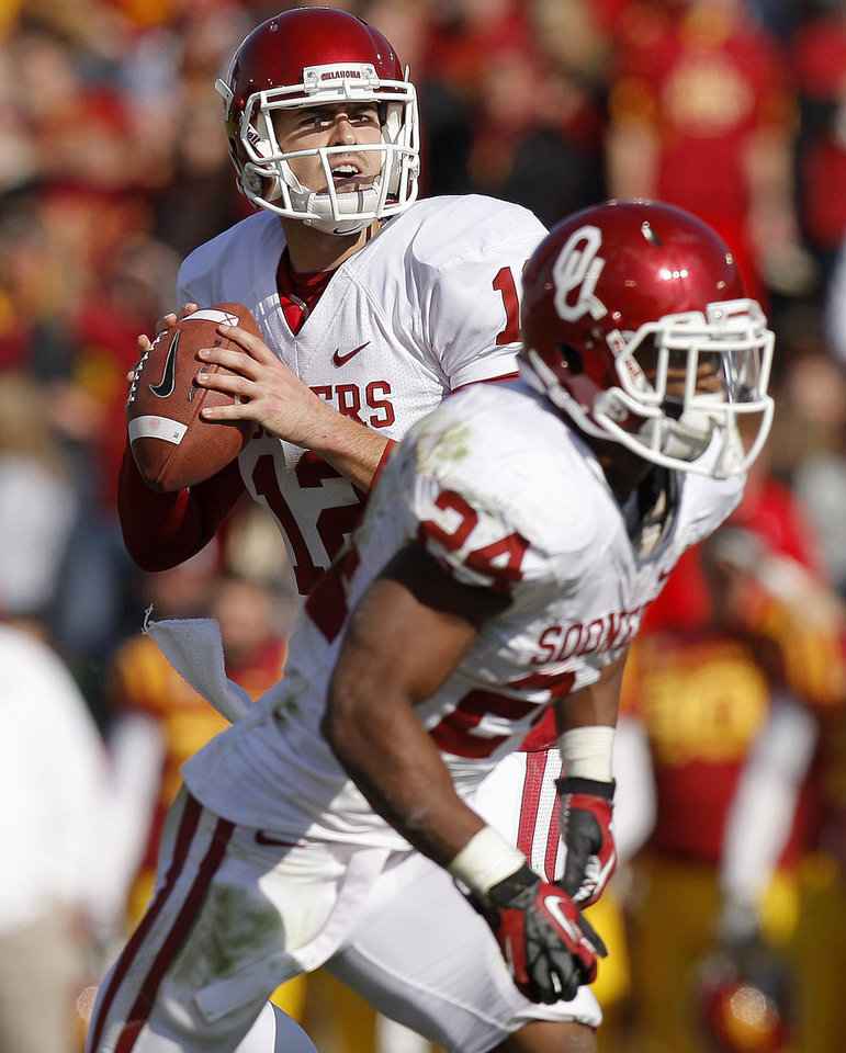 Photo - Oklahoma's Landry Jones (12) drops back to pass during a college football game between the University of Oklahoma (OU) and Iowa State University (ISU) at Jack Trice Stadium in Ames, Iowa, Saturday, Nov. 3, 2012. Oklahoma won 35-20. Photo by Bryan Terry, The Oklahoman