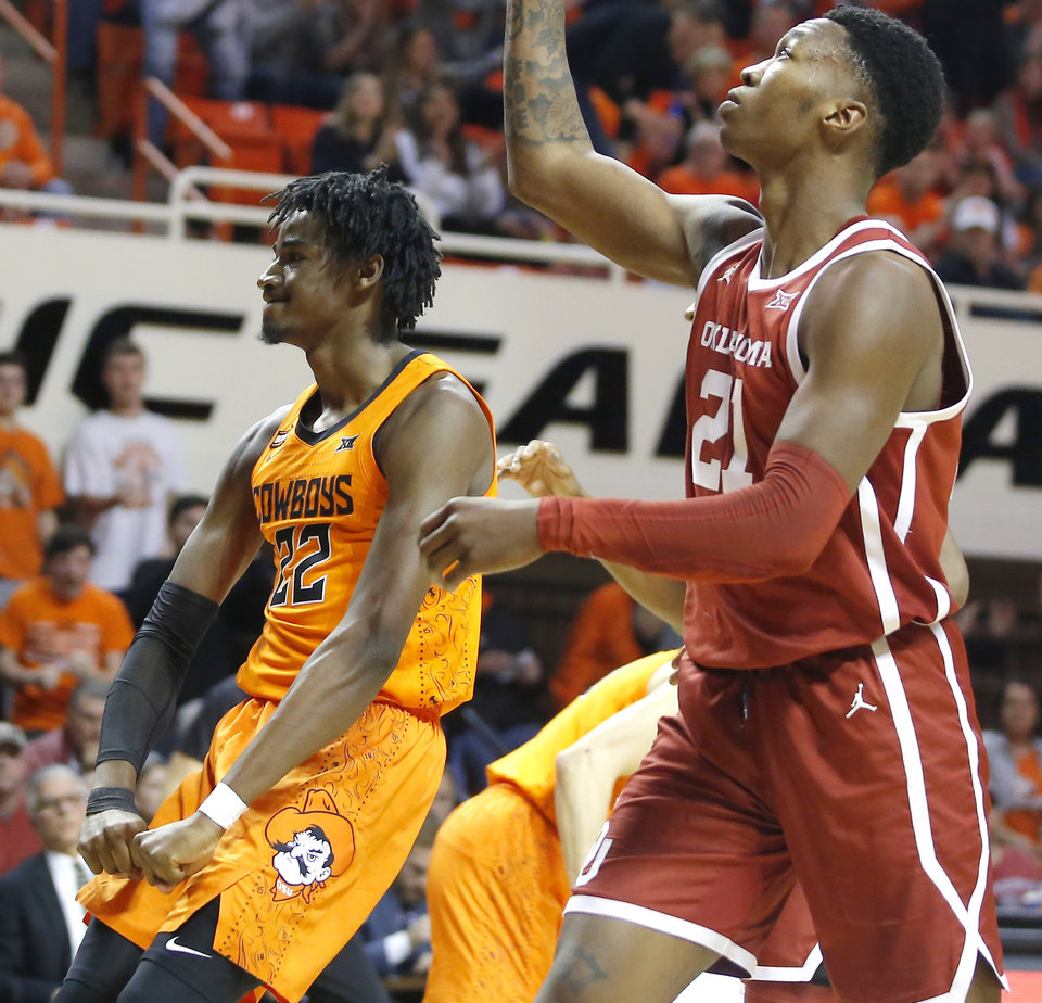 Photo - Oklahoma State's Kalib Boone (22) celebrates beside Oklahoma's Kristian Doolittle (21) during an NCAA men's Bedlam basketball game between the Oklahoma State University Cowboys (OSU) and the University of Oklahoma Sooners (OU) at Gallagher-Iba Arena in Stillwater, Okla., Saturday, Feb. 22, 2020. Oklahoma State won 83-66. [Bryan Terry/The Oklahoman]