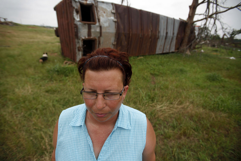 Photo - TORNADO DAMAGE / DEBRIS / ANNIVERSARY: Jackie Dunsworth stands by a boxcar on her property near Shawnee, Okla. Wednesday, June 9, 2010.  The boxcar was thrown across her 55-acre property during the May 10 tornado outbreak.  Photo by Miranda Grubbs, The Oklahoman ORG XMIT: KOD