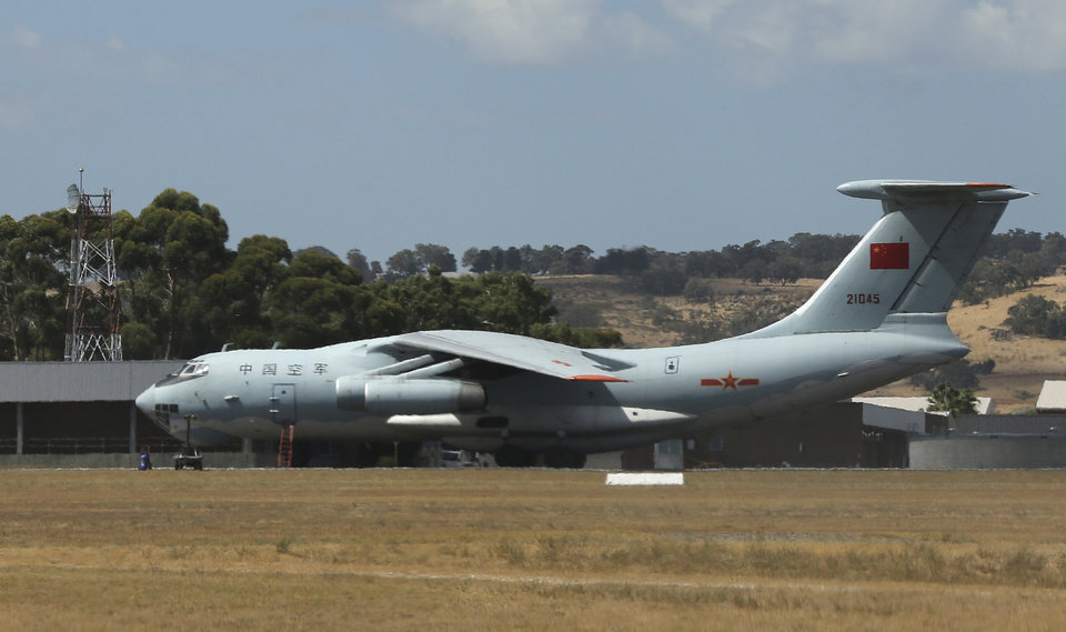 Photo - A Chinese Ilyushin IL-76s aircraft sit on the tarmac at RAAF Pearce base ready to join the search for the missing Malaysia Airlines flight MH370 in Perth, Australia, Sunday, March 23, 2014. More planes were joining the search Sunday of a remote patch of the southern Indian Ocean in hopes of finding answers to the fate of the missing Malaysia Airlines jet, after China released a satellite image showing a large object floating in the search zone.(AP Photo/Rob Griffith)