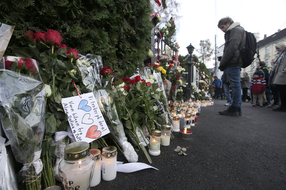 Photo - Flowers are placed in front of the French embassy in Oslo, Norway, Saturday Nov. 14, 2015, for the victims killed in Friday's attacks in Paris. French President Francois Hollande said more than 120 people died Friday night in shootings at Paris cafes, suicide bombings near France's national stadium and a hostage-taking slaughter inside a concert hall. (Vidar Ruud/NTB Scanpix via AP) NORWAY OUT