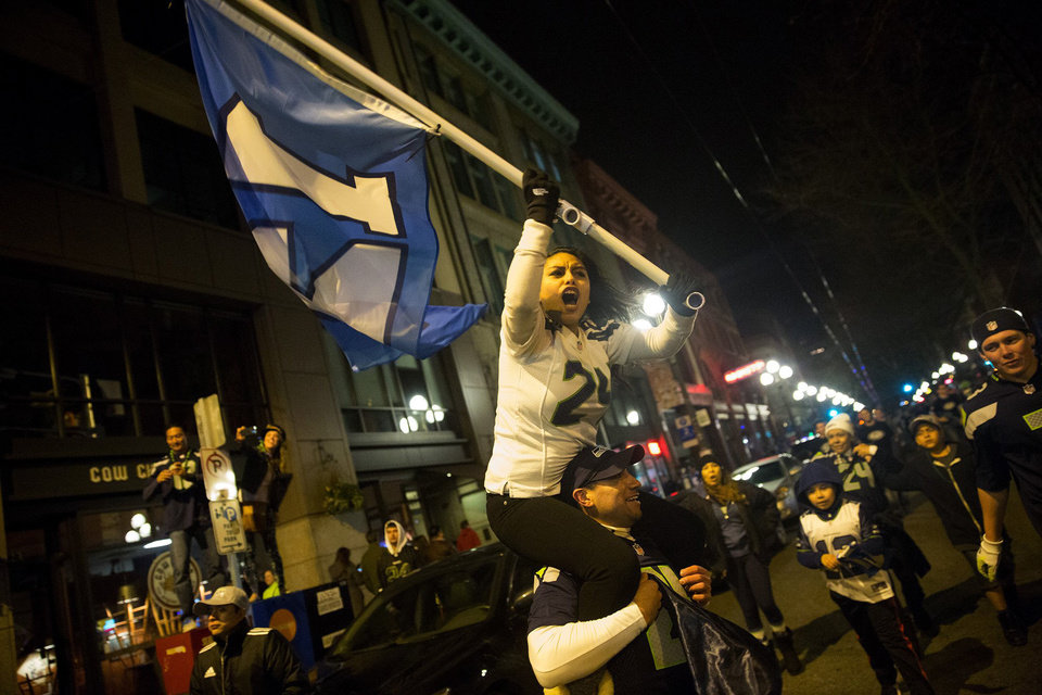 Photo - Thousands of Seattle Seahawk fans celebrate in the Pioneer Square neighborhood in Seattle after  the Seahawks Super Bowl win Sunday, Feb. 2, 2014, over the Denver Broncos. (AP Photo/The Seattle Times, Erika Schultz)