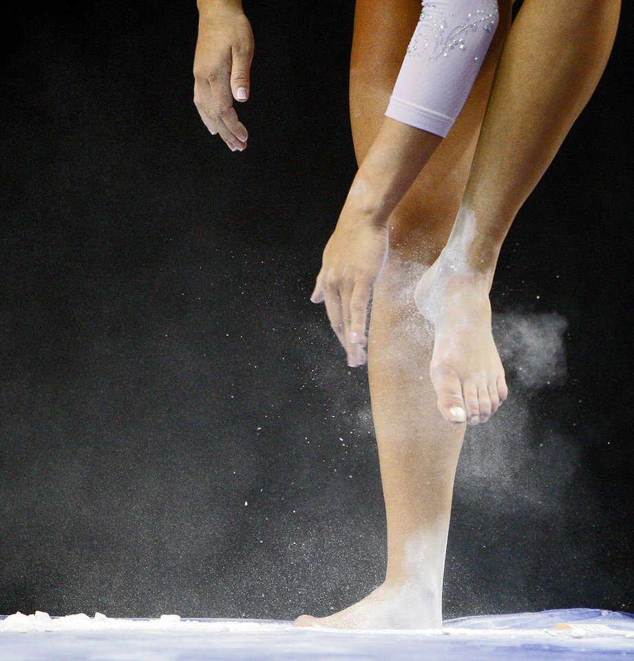Oklahoma's Madison Mooring puts chalk on her feet before competing on the beam during the Perfect 10 Challenge hosted by the Bart and Nadia Sports and Health Festival at the Cox Convention Center in Oklahoma City, Friday, Feb. 10, 2012. Photo by Bryan Terry, The Oklahoman