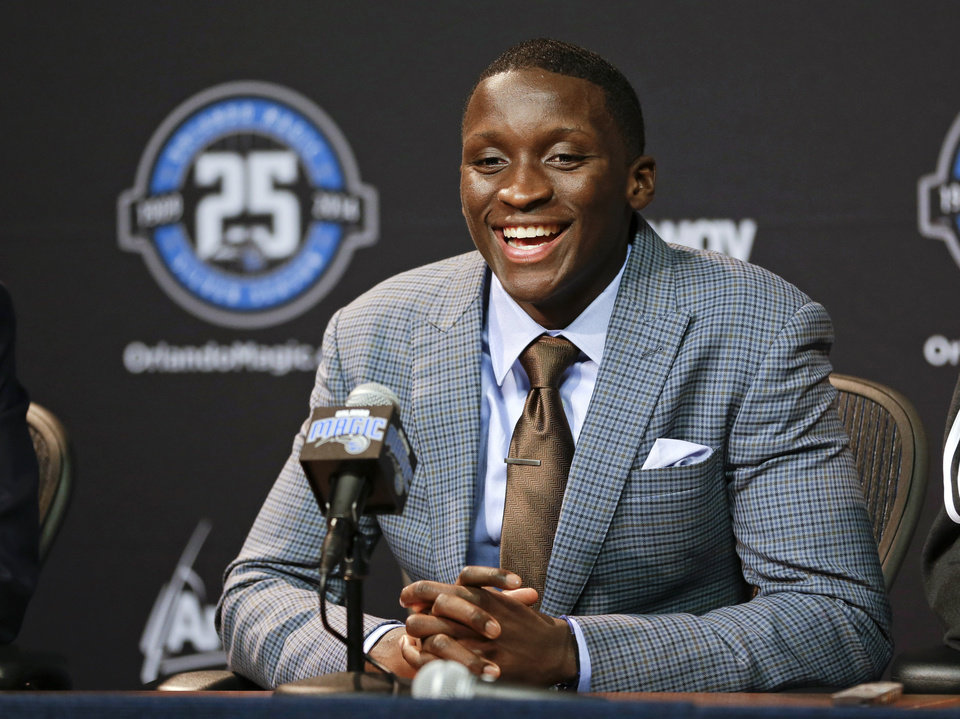 Photo - Orlando Magic first-round NBA basketball draft pick Victor Oladipo speaks with reporters at a news conference, Friday, June 28, 2013, in Orlando, Fla. (AP Photo/John Raoux)