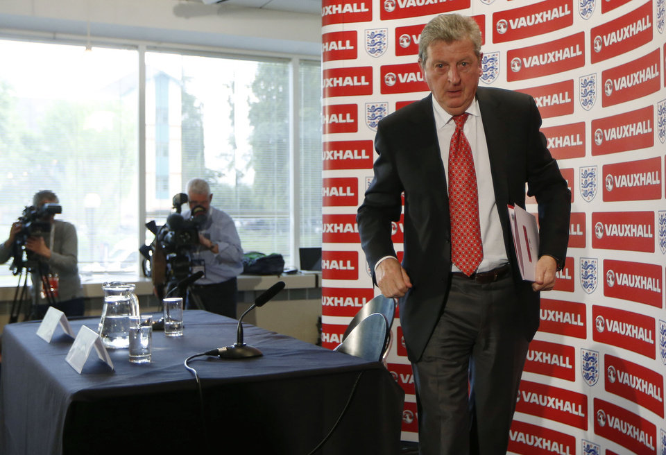 Photo - England's soccer manager Roy Hodgson leaves, after announcing the squad for the World Cup in Brazil at Vauxhall headquarters,  in Luton, England, Monday, May 12, 2014.  England coach Roy Hodgson selected a World Cup squad containing several young players on Monday, although Frank Lampard was among the veterans to still make the cut. (AP Photo/Sang Tan)