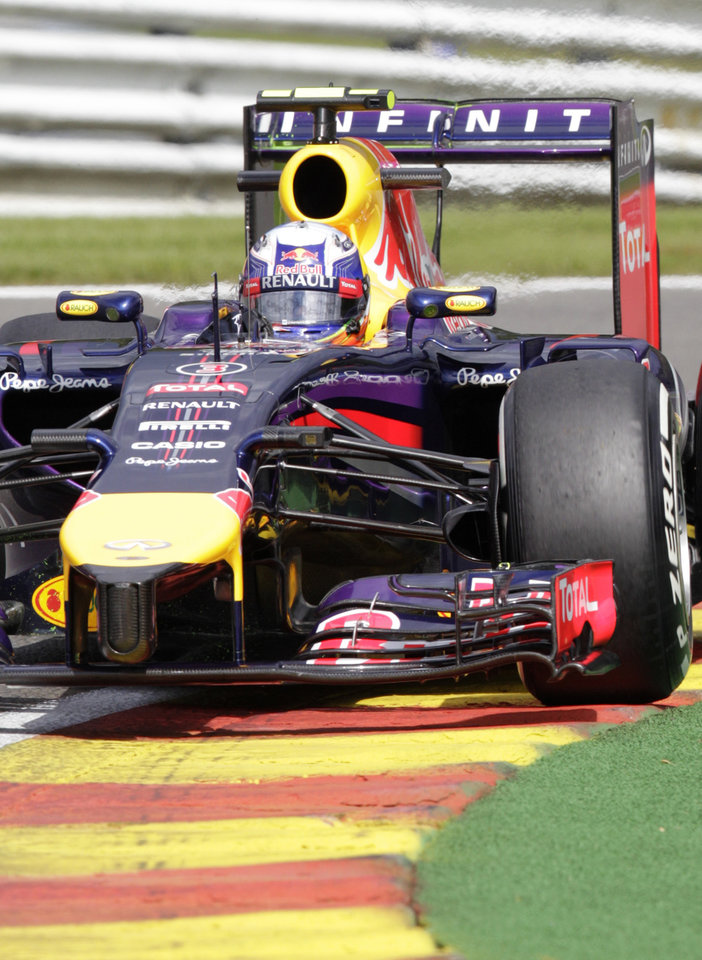 Photo - Red Bull driver Daniel Ricciardo of Australia steers his car during the second practice session ahead of Sunday's Belgian Formula One Grand Prix in Spa-Francorchamps, Belgium, Friday, Aug. 22, 2014. (AP Photo/Yves Logghe)